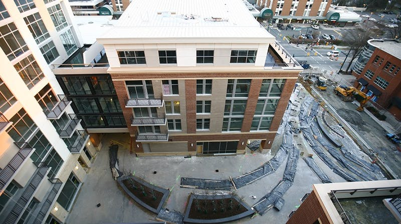 140 West continues development for residential and retail spaces to open this spring. The development aims to fill the gap between East and West Franklin St., and bridge the gap between Franklin St. and Rosemary St., says Jon Keener, development manager of Ram Realty Services.The view from the top floor of the development shows the full plaza, Franklin Street and already established spaces around it.