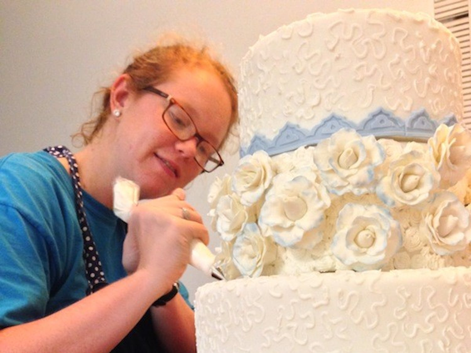 Elizabeth Graham is entering a wedding cake into the amateur cake category at the North Carolina State Fair.