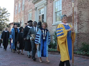 The University Day procession, including Chancellor Carol Folt and Student Body President Bradley Opere, makes its way from South Building to Memorial Hall.