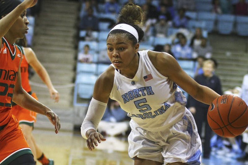 North Carolina first year guard Stephanie Watts (5) drives towards the basket during Sunday afternoon's basketball game against the University of Miami.