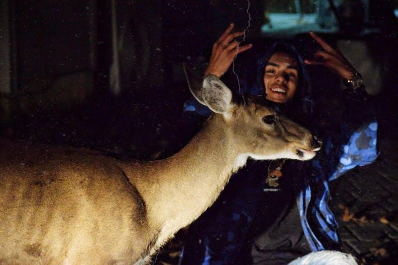 Kelvin Peña with an unspecified deer friend.Photo courtesy of KelvinPeña