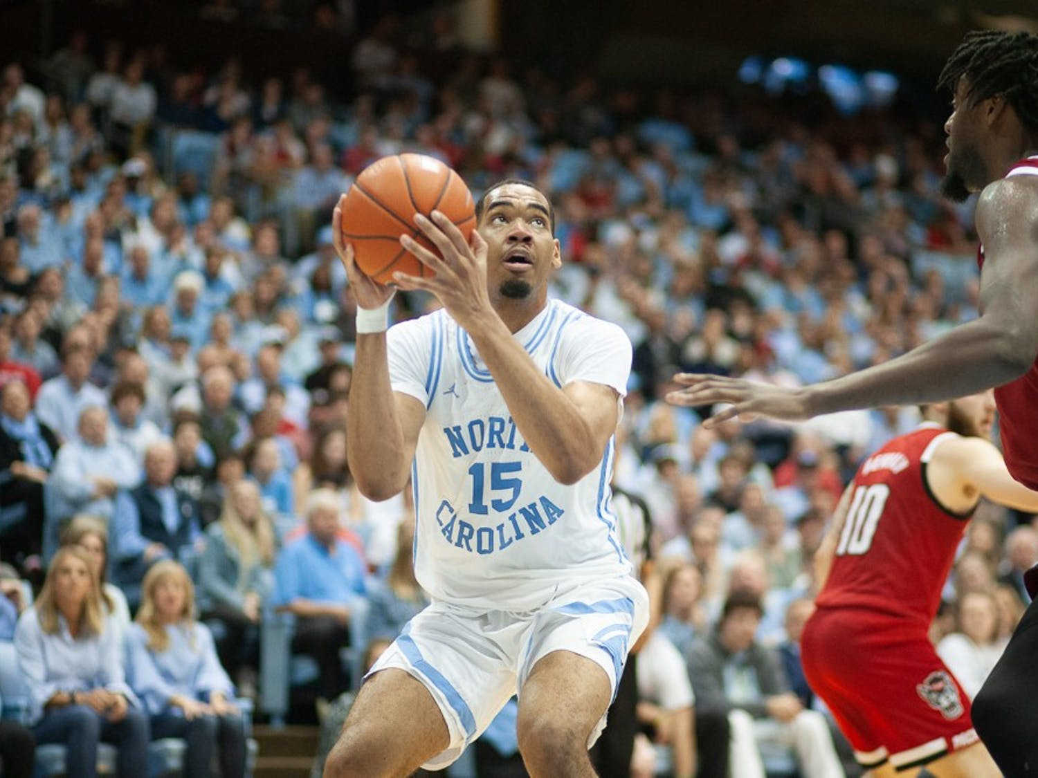 UNC junior forward Garrison Brooks (15) prepares to take a shot in the game against N.C. State in the Smith Center on Tuesday, Feb. 25, 2020.