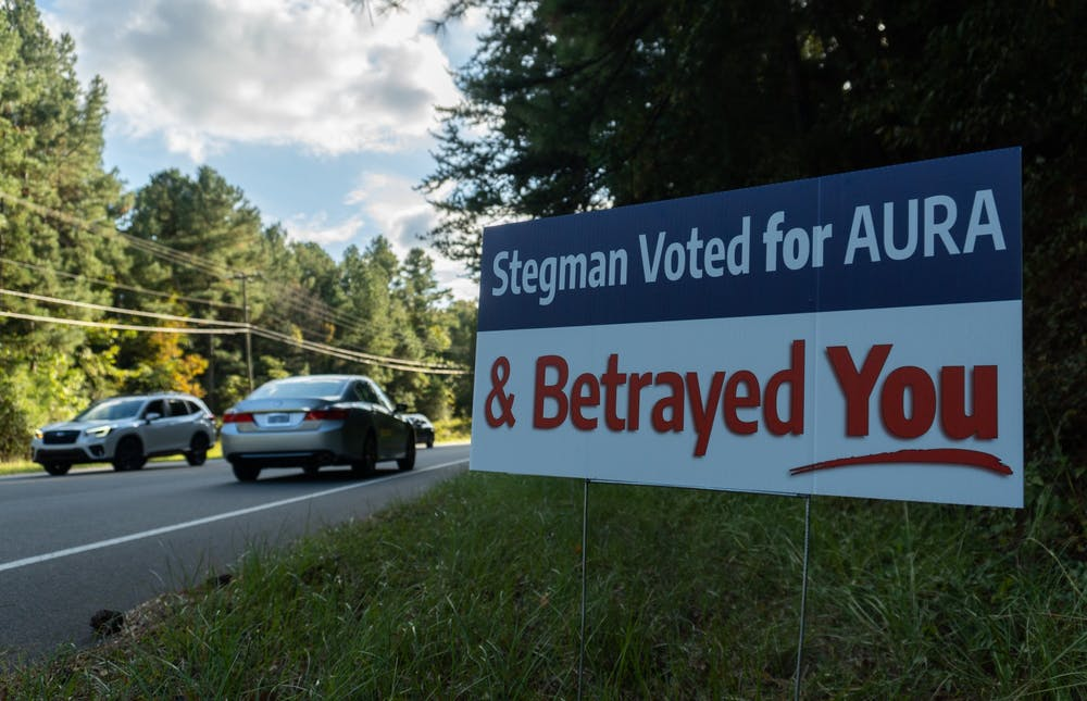 <p>Anonymous road signs along Estes Dr. and Village Dr. criticize Karen Stegman for betraying Chapel Hill.</p>