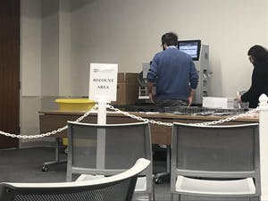 A recount completed on Thursday, Nov. 21, 2019 officially confirmed UNC senior Tai Huynh has taken incumbent Nancy Oates' seat in the race for Chapel Hill Town Council.