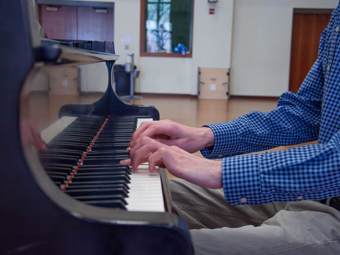 Alex McKeveny, music major, plays the piano in the Kenan Music Building Rehearsal Room on March 21, 2021. The UNC Advanced Composition class (MUSC 266) collaborated with an animation class at NC State to produce animated videos of original music pieces students wrote.