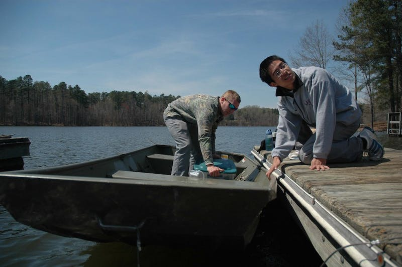 Josh Weinstein and Eric Dean dock their boat to get ready for the weigh-in.