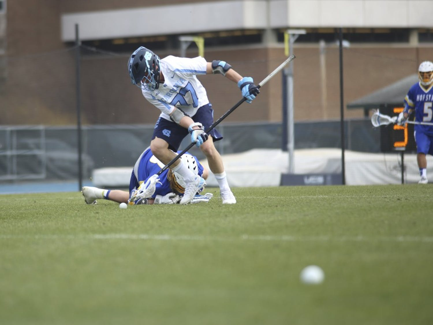 UNC defenseman Zach Powers (77) goes for the ball Saturday afternoon against Hofstra. The Tar Heels fell 10-5.