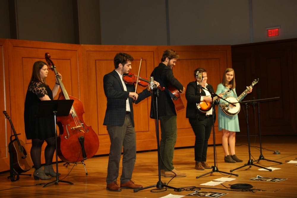 <p>Reese Krome plays the fiddle at the Fall 2017 Carolina Bluegrass Band concert. Photo courtesy of Kandis Johnson.&nbsp;</p>