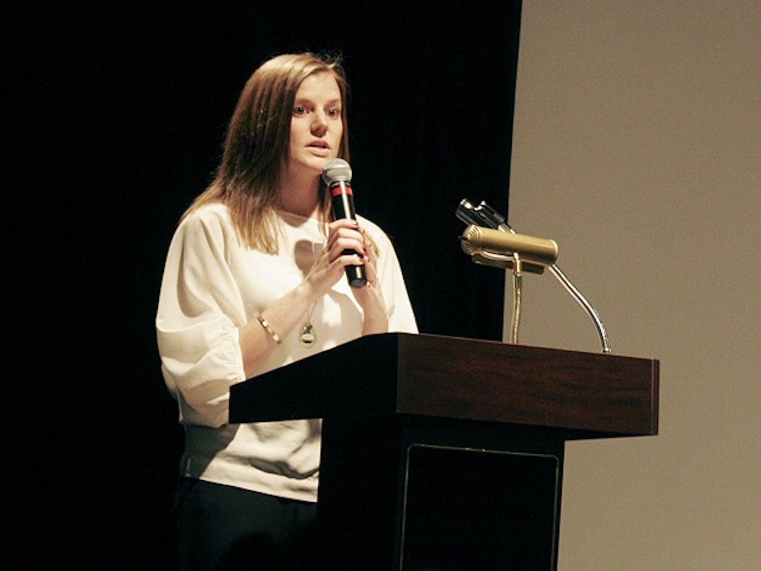 Laurie Graham, programs director at the Orange County Rape Crisis Center, explains the forum for sexual assault victims on Tuesday night.