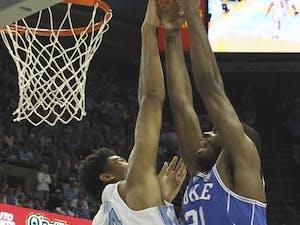 North Carolina forward Isaiah Hicks (4) attempts to block Duke forward Amile Jefferson (21) Saturday.