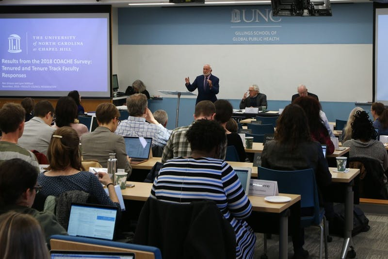 Executive Vice Provost Ronald Strauss presents results from the 2018 COACHE Survey on tenured and tenure track faculty at the Faculty Council Meeting in Rosenau Hall on Friday, Nov. 8, 2019.