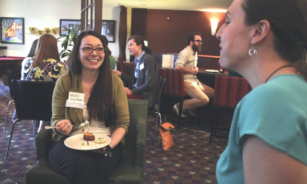 <p>Kelly Kleinbrahm, a Chapel Hill Professionals member, attends a Chapel Hill Young Professionals networking event at the Residence Inn in March 2015. (Courtesy of&nbsp;Nicholas C. Johnson)</p>