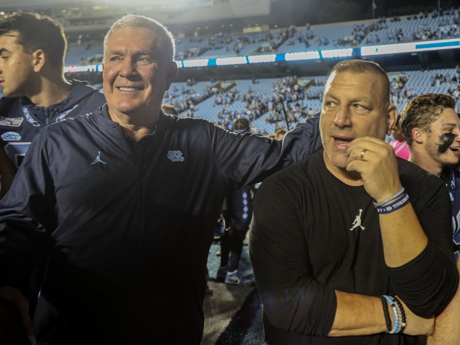 Head Coach Mack Brown and Offensive coordinator Phil Longo celebrate UNC's win on Saturday, Oct. 26, 2019. UNC defeated Duke 20-17.