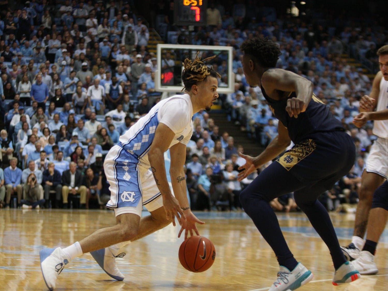 UNC guard Cole Anthony prepares to drive against Notre Dame guard T.J. Gibbs (10) on Wednesday, Nov. 6, 2019 in the Dean E. Smith Center. The Tar Heels beat the Fighting Irish 76-65.