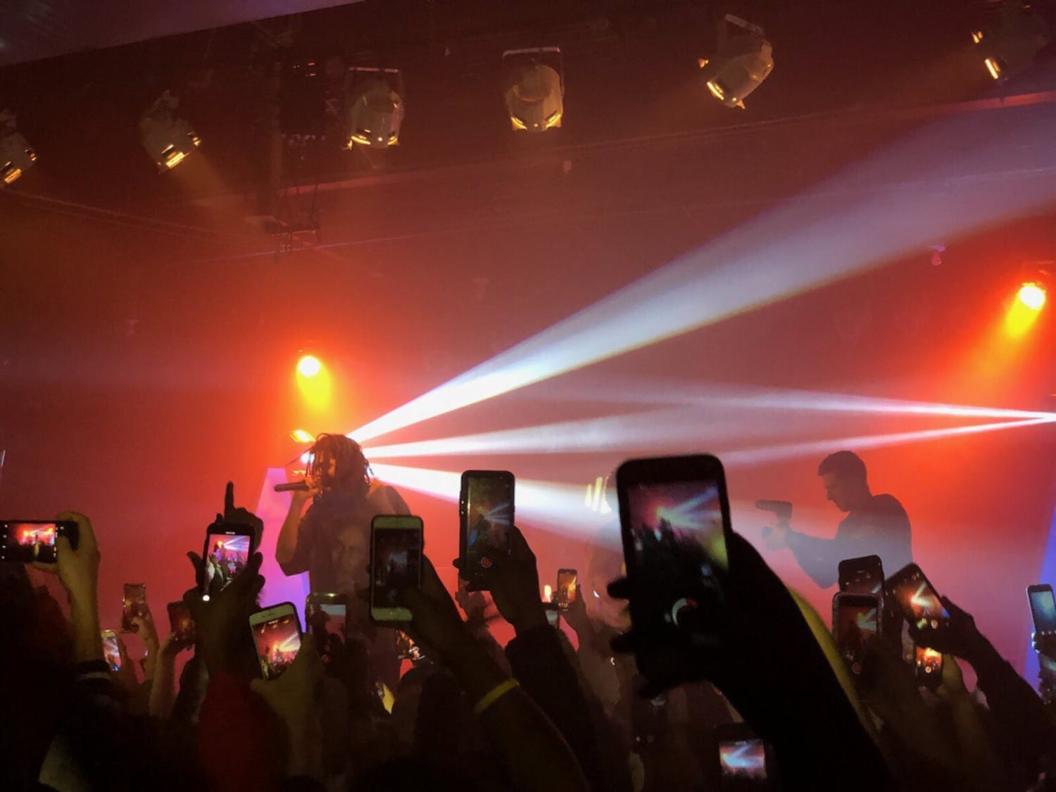 Photo courtesy of Caroline Todd  Picture of J.Cole on stage with Bas at surprise appearence