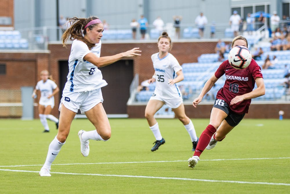 <p>UNC Sophomore Forward Emily Moxley (8) pursues the ball during the Tar Heels' game against the Arkansas Razorbacks at Dorrance Field on Sunday, Aug. 22.</p>