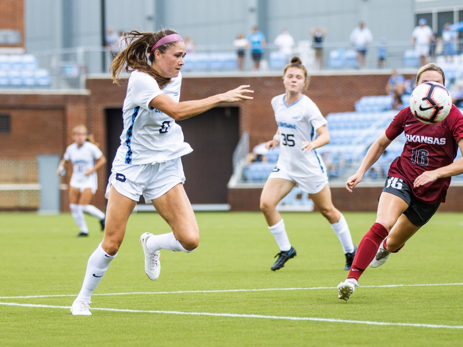 UNC Sophomore Forward Emily Moxley (8) pursues the ball during the Tar Heels' game against the Arkansas Razorbacks at Dorrance Field on Sunday, Aug. 22.