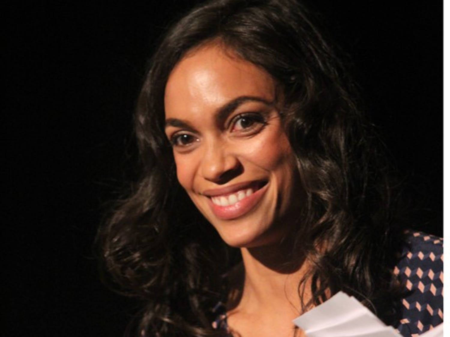 Rosario Dawson leads a panel discussion at the DNC on Tuesday.