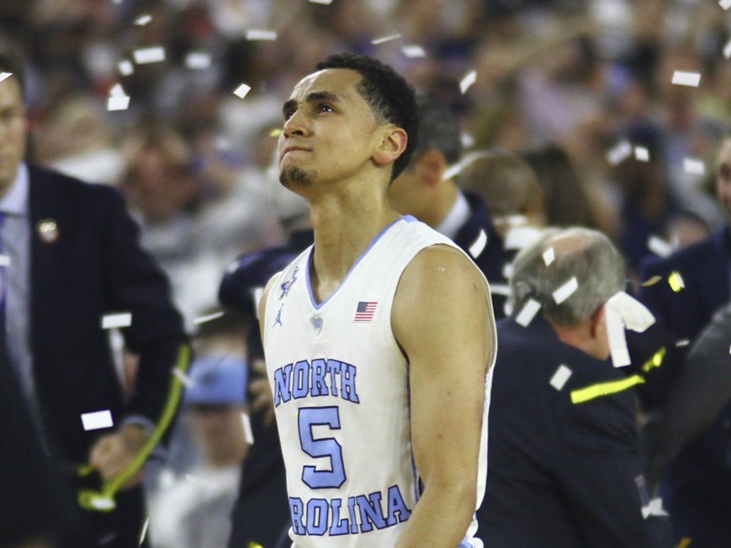 Senior Marcus Paige (5) walks off the court after a buzzer beater 77-74 loss to Villanova. Paige had made a three-pointer to briefly tie the game.
