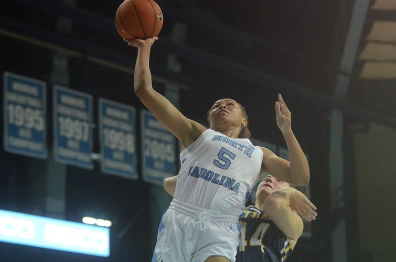 UNC women's basketball redshirt junior Stephanie Watts goes in for a layup during Friday's game against Kent State. UNC won the game 73-60.