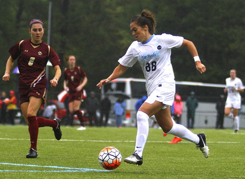 The women's soccer team defeated Boston College on a rainy Friday afternoon, Oct. 2, with a score of 2-0. Alexa Newfield (88) pushes the ball up the field.