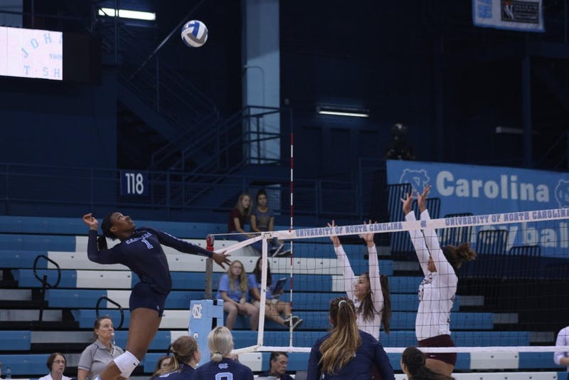 Outside Hitter Destiny Cox (1) goes for a spike against Maryland Eastern Shore Aug. 31 in Chapel Hill.
