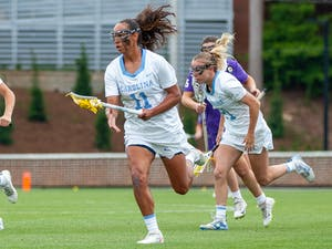 UNC senior defender Kayla Wood (11) runs with the ball at the second round of the NCAA tournament against James Madison on Sunday May 16, 2021 at the Dorrance Field in Chapel Hill. The Tar Heels won 14-9.