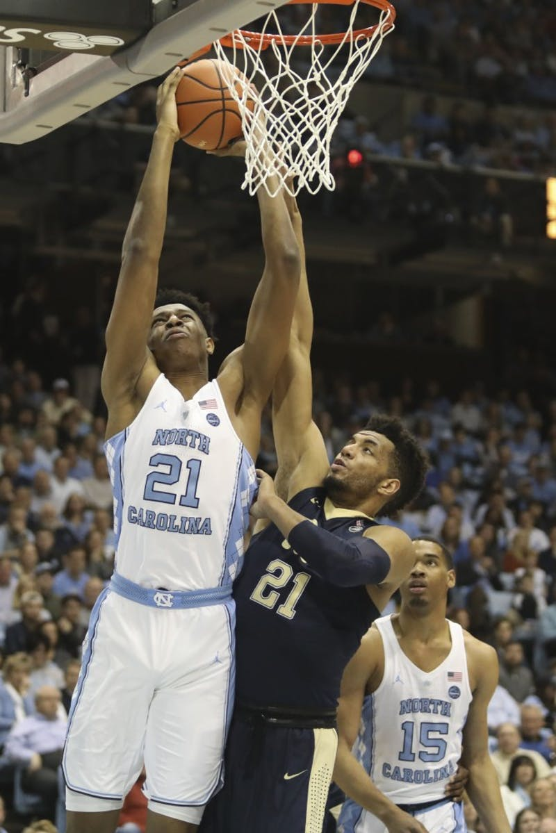 Forward Sterling Manley (21) attempts a contested dunk against Pittsburgh on Feb. 3 in the Smith Center.