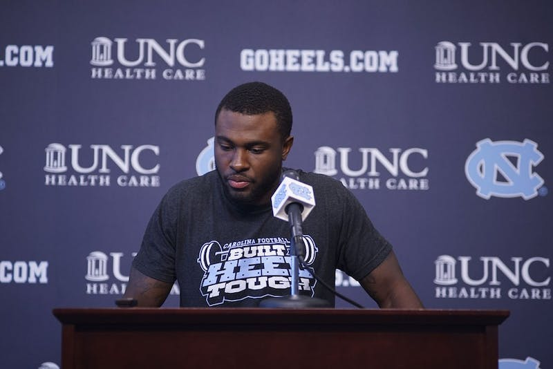 UNC Safety Donnie Miles speaks at a press conference inside Kenan Football Center at a press conference Monday.