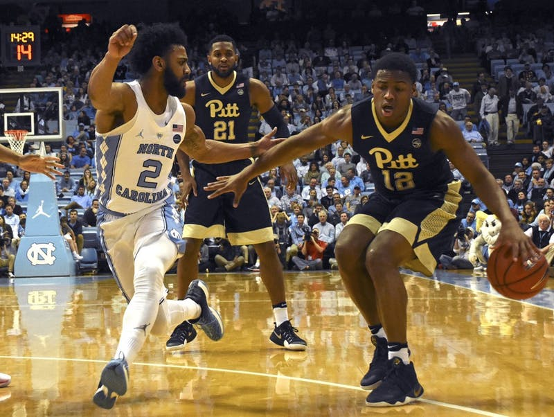 UNC guard, Joel Berry II (#2) blocking No.  12 against Pittsburgh on Tuesday.