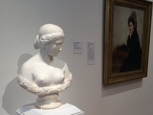 """""""Daphne,"""" a bust by Harriet Hosmer, is displayed next to Mary Cassatt's """"Portrait of Madame X Dressed for the Matinee."""" Courtesy of the NCMA."""