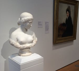 """Daphne,"" a bust by Harriet Hosmer, is displayed next to Mary Cassatt's ""Portrait of Madame X Dressed for the Matinee."" Courtesy of the NCMA."