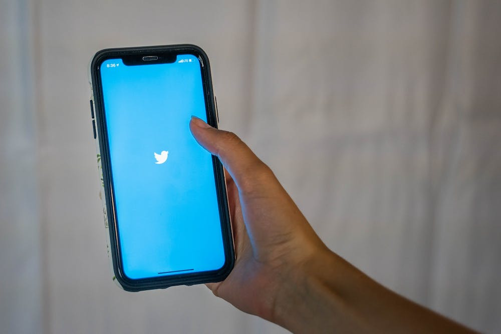 <p>DTH Photo Illustration. A student pulls up the Twitter app on their phone. With UNC's campus shutdown in the spring, more and more students have turned to social media for activist work.</p>