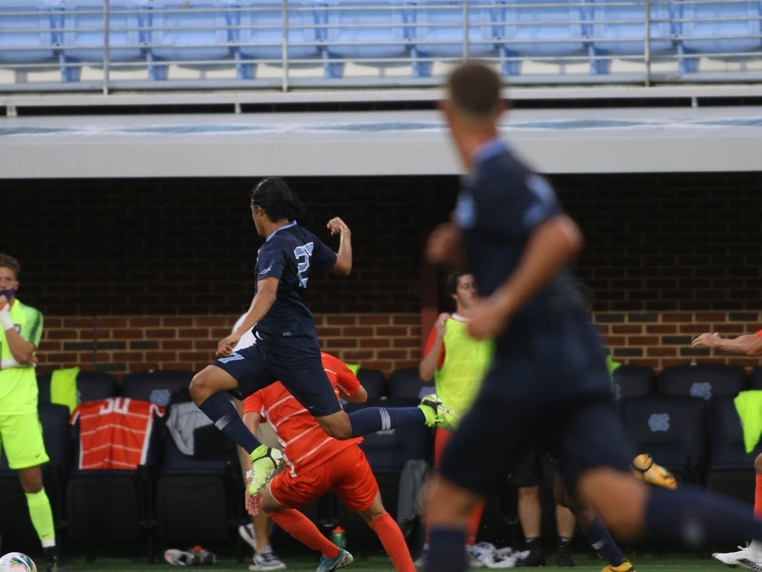 UNC senior forward Lucas del Rosario (7) attempts to kick the ball during a a game against Clemson at Dorrance Field on Friday, Oct. 9, 2020. UNC won 1-0.