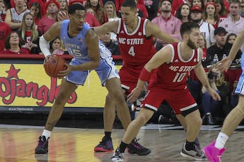 UNC Junior forward Garrison Brooks (15) looks to pass the ball in the game against N.C. State on Monday, Jan. 27, 2020 at the PNC Arena in Raleigh, N.C.