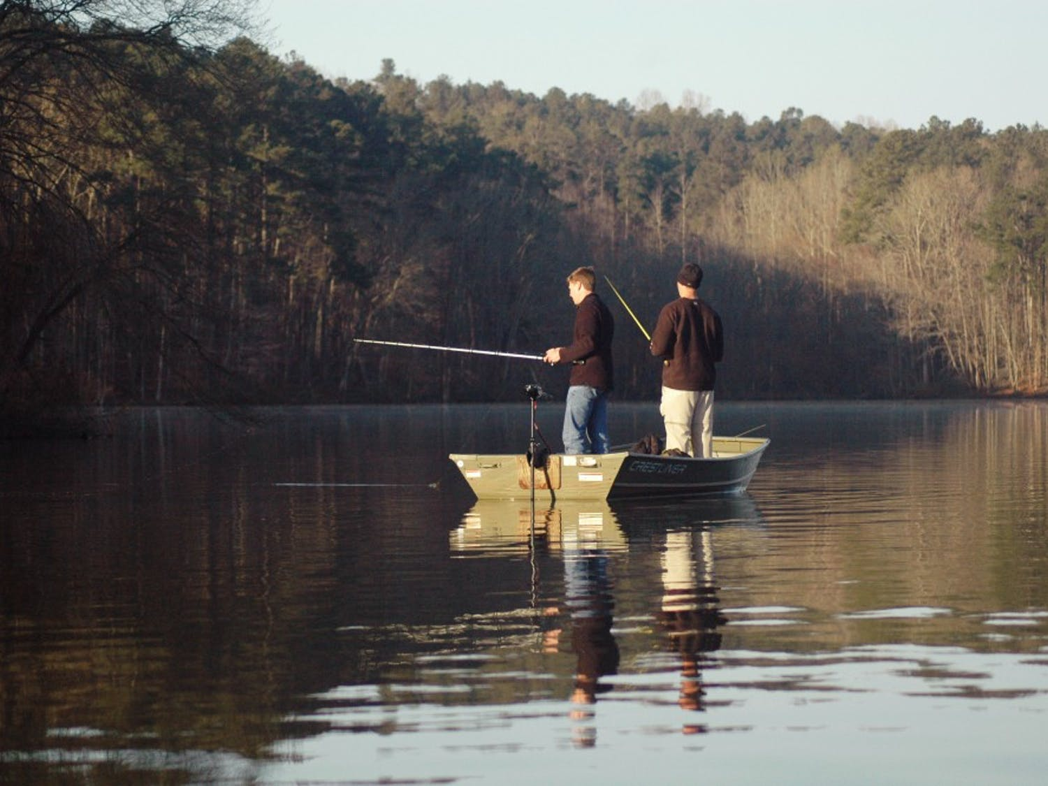 A duo of participants test their luck during the 3rd annual bass fishing competition between Duke and UNC. Eighteen fishers drove out to University Lake in Chapel Hill for the Sunday morning event.