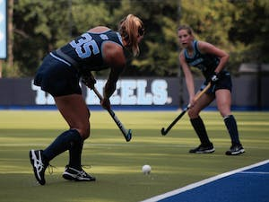 Back Ellen Payne (35) passes the ball on Sept. 15, 2019. UNC's field hockey team won 8-0 against William and Mary.