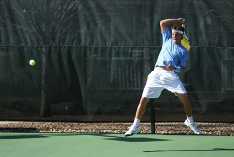 ose Hernandez returns a ball against Auburn's Tim Hewitt on Friday at UNC's Cone-Kenfield Tennis Center. DTH/Lauren McCay