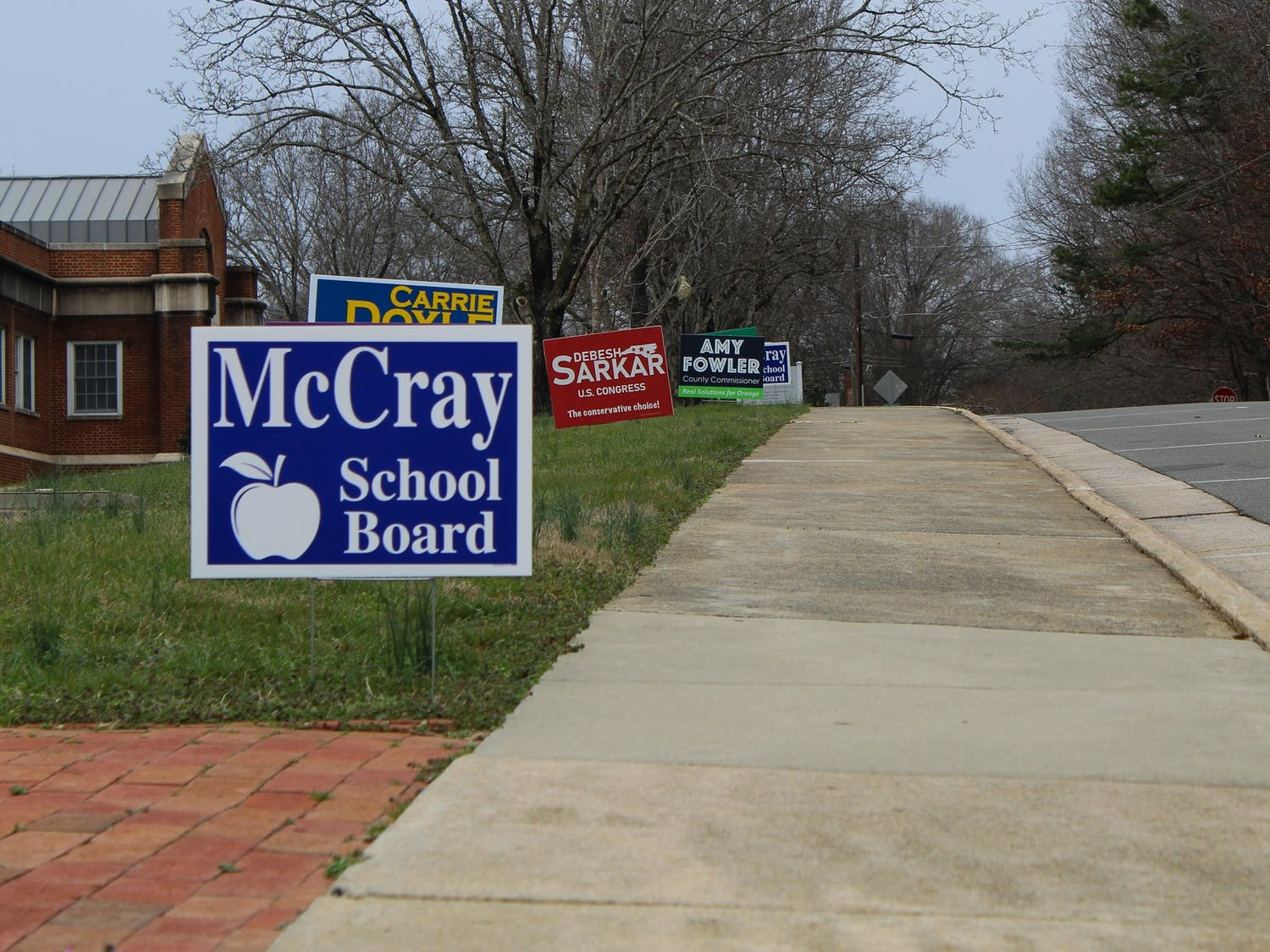 Candidate signs stand outside the Orange County Board of Elections building in Hillsborough, N.C., ahead of the March 3, 2020 primary on Feb. 8, 2020.