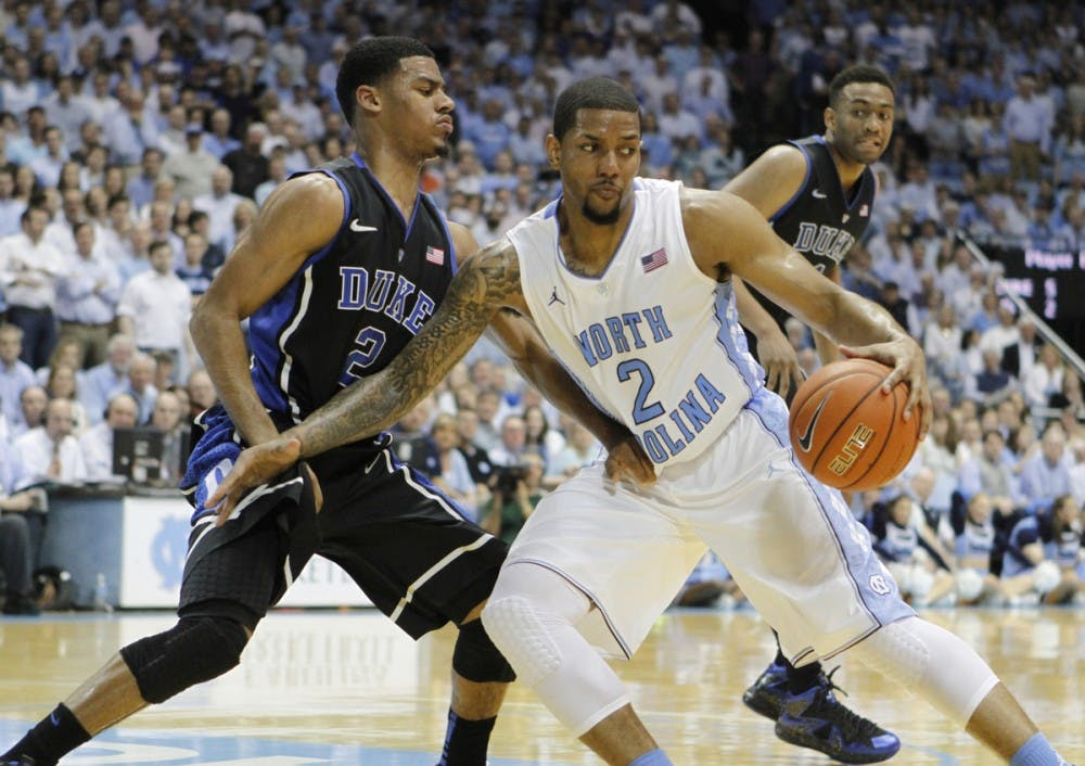 <p>Leslie McDonald drives to the basket. UNC defeated Duke 74-66 at the Smith Center on Thursday, Feb. 20, 2014.&nbsp;</p>