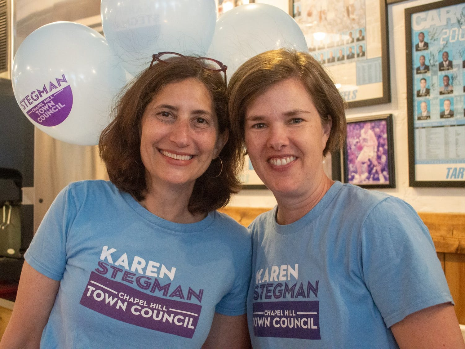 Council Member Karen Stegman smiles with her wife, Alyson Grine, at Italian Pizzeria III on Saturday June, 12, 2021, to celebrate Karen's reelection campaign.