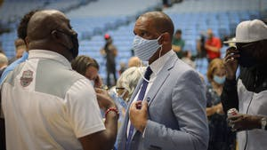 Hubert Davis socializes after his introductory press conference on Tuesday, April 6, 2021.