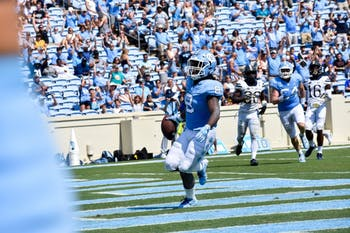 Tailback Michael Carter (8) celebrates after scoring a touchdown. UNC won 38-35 vs. Pitt on Saturday, Sept. 22 2018.