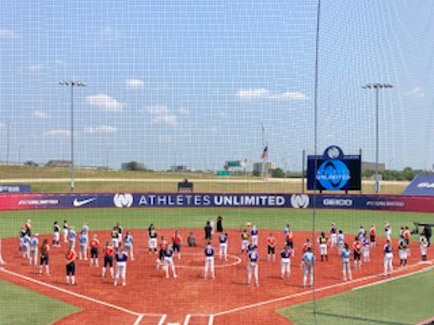 Players participate in the closing ceremony of Athletes Unlimited's summer softball league this past summer. Photo courtesy of Athletes Unlimited.