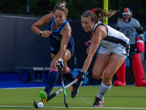 First-year forward Kennedy Cliggett (36) fights for the ball at the field hockey game against Louisville on Oct. 22 at the Karen Shelton Stadium. UNC lost 2-3 in overtime.