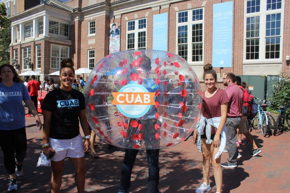 <p>Students walk around the pit before announcing who will be performing at the Carolina Union Activities Board homecoming show. Accounts managed by the Student Activities Fund Office, which control money distributed to student organizations by the Undergraduate Senate, will be managed by CUAB as SAFO is phased out.</p>