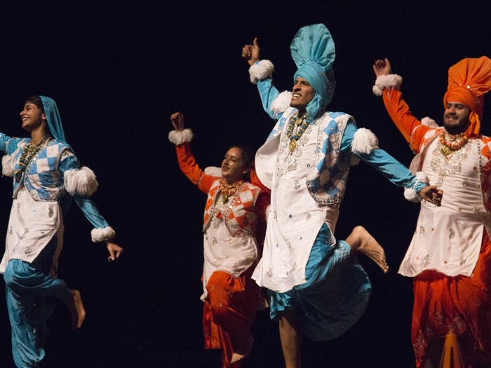 Dancers (from left to right) Alisha Abhayakumar, Aanchal Murjal, Benjamin Chilampath, and Ashwin Punj dance a traditional dance for Bhangra Elite at the Aaj Ka Dhamaka dance competition on Saturday, Nov. 17, 2018 in Memorial Hall at the University of North Carolina at Chapel Hill.