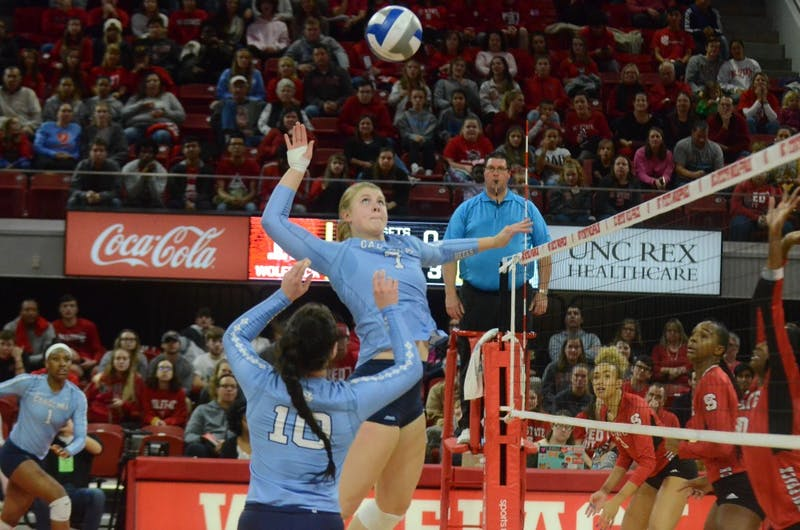 UNC's middle hitter Katharine Esterley (7) prepares to spike the ball during the game against N.C. State on Wednesday, Nov. 14. UNC lost to State 3-0.