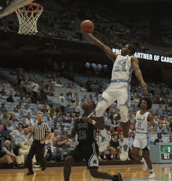 Guard Kenny Williams (24) drives to the basket during Friday's exhibition versus Mount Olive in the Dean Dome. UNC won 107-64.