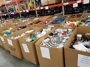 A couple of boxes showing TROSA's donations. Photo courtesy of Jeff Stern.